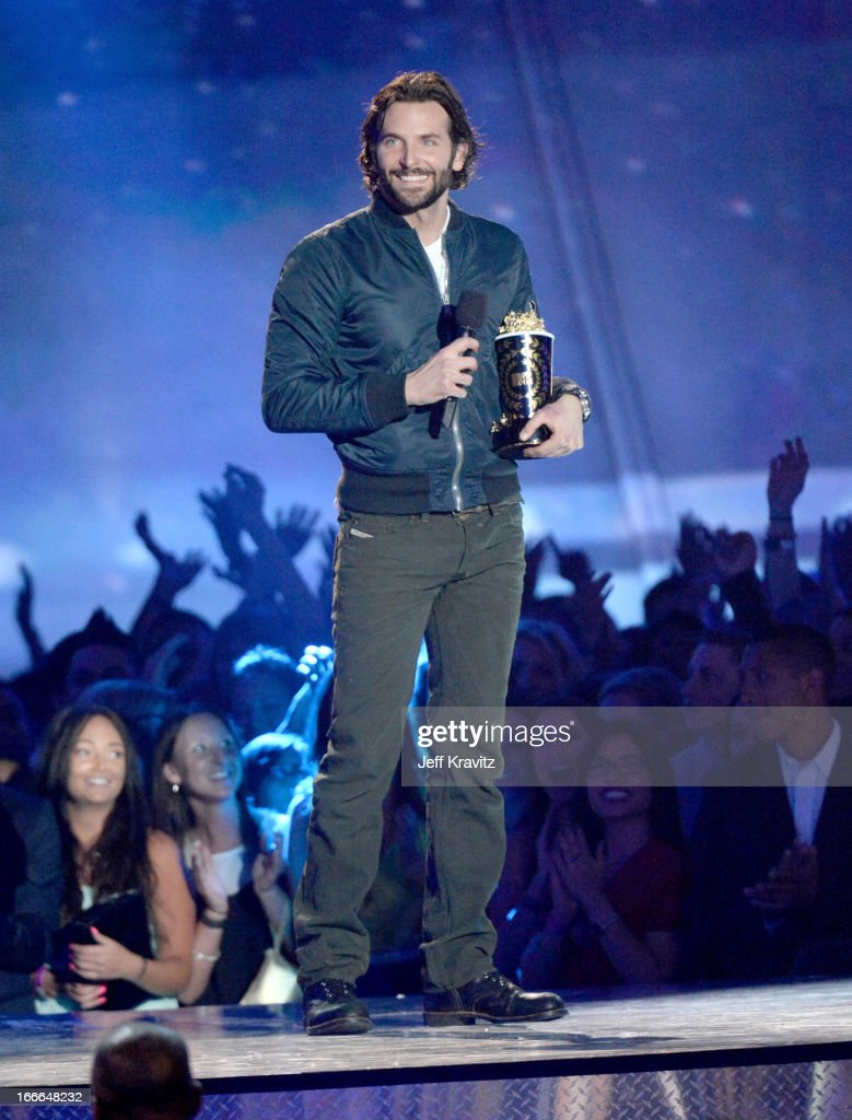 Actor Bradley Cooper speaks onstage during the 2013 MTV Movie Awards at Sony Pictures Studios on April 14, 2013 in Culver City, California.