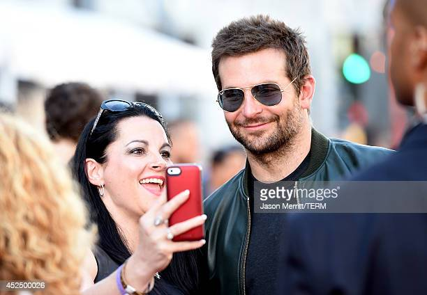 Actor Bradley Cooper takes a seflie with a fan at the premiere of Marvel's 'Guardians Of The Galaxy' at the Dolby Theatre on July 21 2014 in...