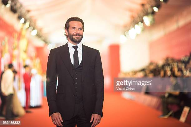 Actor Bradley Cooper walks the red carpet of the 19th Shanghai International Film Festival at Shanghai Grand Theatre on June 11 2016 in Shanghai China