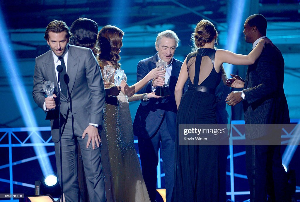 Actor Bradley Cooper (L) with Robert De Niro and Jennifer Lawrence accept the Best Acting Ensemble Award for 'Silver Linings Playbook' onstage at the 18th Annual Critics' Choice Movie Awards held at Barker Hangar on January 10, 2013 in Santa Monica, California.