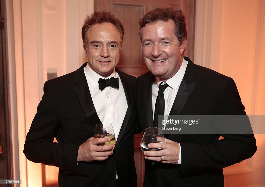 Actor Bradley Whitford, left, and television host Piers Morgan attend the Bloomberg Vanity Fair White House Correspondents' Association (WHCA) dinner afterparty in Washington, D.C., U.S., on Saturday, April 27, 2013. The 99th annual dinner raises money for WHCA scholarships and honors the recipients of the organization's journalism awards. Photographer: Andrew Harrer/Bloomberg via Getty Images