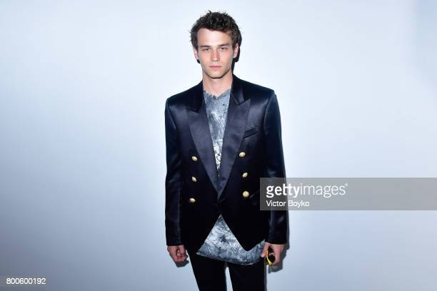 Actor Brandon Flynn attends the Balmain Menswear Spring/Summer 2018 show as part of Paris Fashion Week on June 24 2017 in Paris France