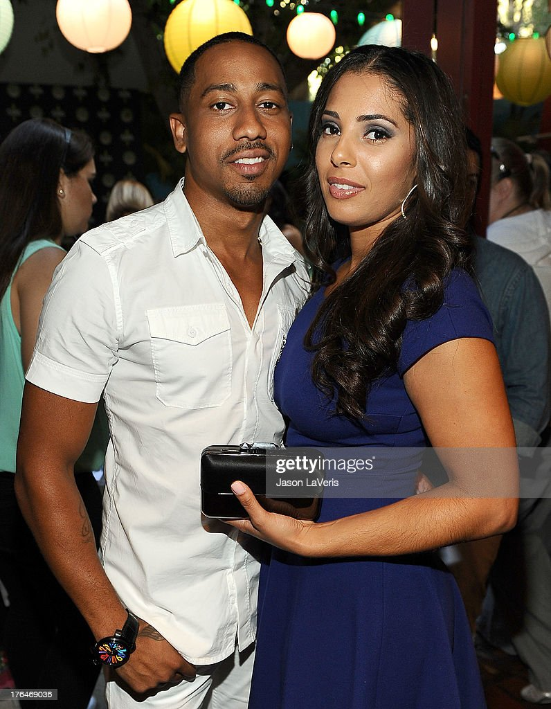Actor Brandon T. Jackson and Denise Marie Xavier pose in the green room at the 2013 Teen Choice Awards at Gibson Amphitheatre on August 11, 2013 in Universal City, California.