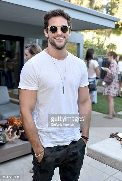 Actor Brant Daugherty trying on Sama Eyewear attends the Vince Camuto Mens exclusive preview at the home of Ashlee Margolis on October 28 2015 in...
