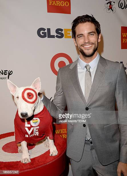 Actor Brant Daugherty with Bullseye the Target dog arrives at the 9th Annual GLSEN Respect Awards at Beverly Hills Hotel on October 18 2013 in...