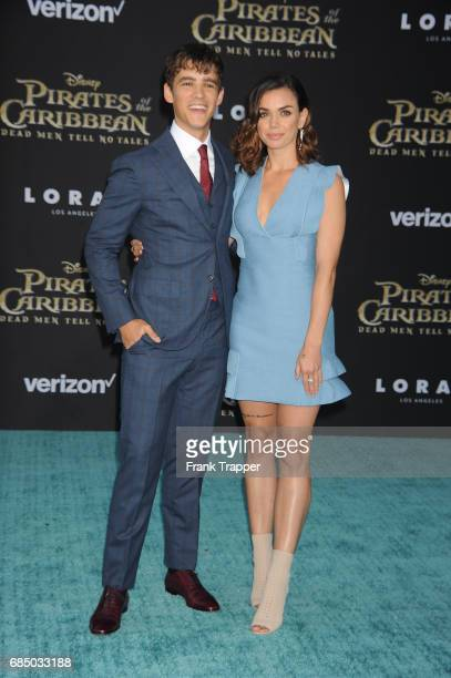 Actor Brenton Thwaites and Chloe Pacey arrive at the premiere of Disney's 'Pirates of the Caribbean Dead Men Tell No Tales' at the Dolby Theatre on...