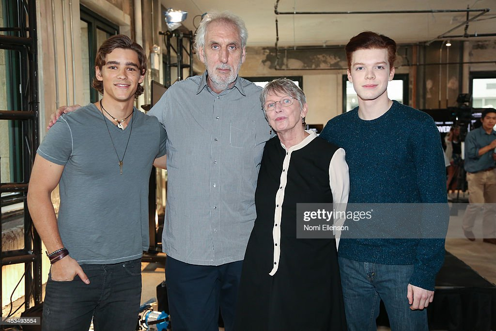 Actor Brenton Thwaites, director Phillip Noyce, author Louis Lowry, and actor Cameron Monaghan attend AOL's Build Speaker Series Presents: 'The Giver' Author, Director & Cast at AOL Studios In New York on August 11, 2014 in New York City.