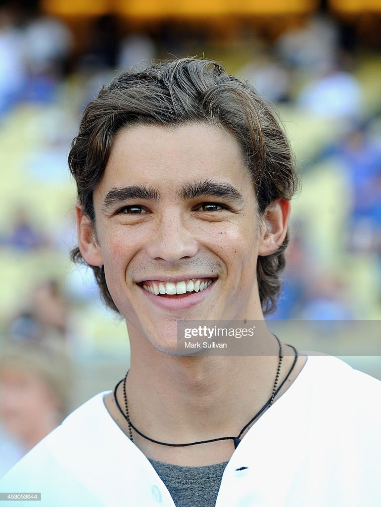 Actor <a gi-track='captionPersonalityLinkClicked' href=/galleries/search?phrase=Brenton+Thwaites&family=editorial&specificpeople=10008512 ng-click='$event.stopPropagation()'>Brenton Thwaites</a> on the feild before the game between the Chicago Cubs and Los Angeles Dodgers at Dodger Stadium on August 1, 2014 in Los Angeles, California.