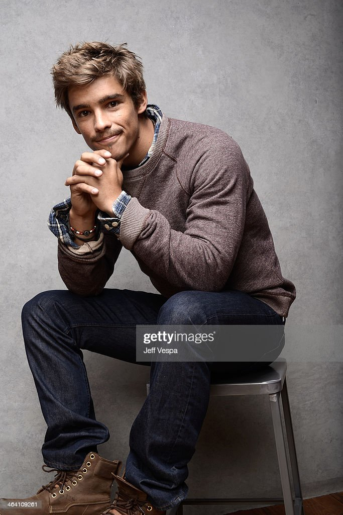 Actor Brenton Thwaites poses for a portrait during the 2014 Sundance Film Festival at the WireImage Portrait Studio at the Village At The Lift...