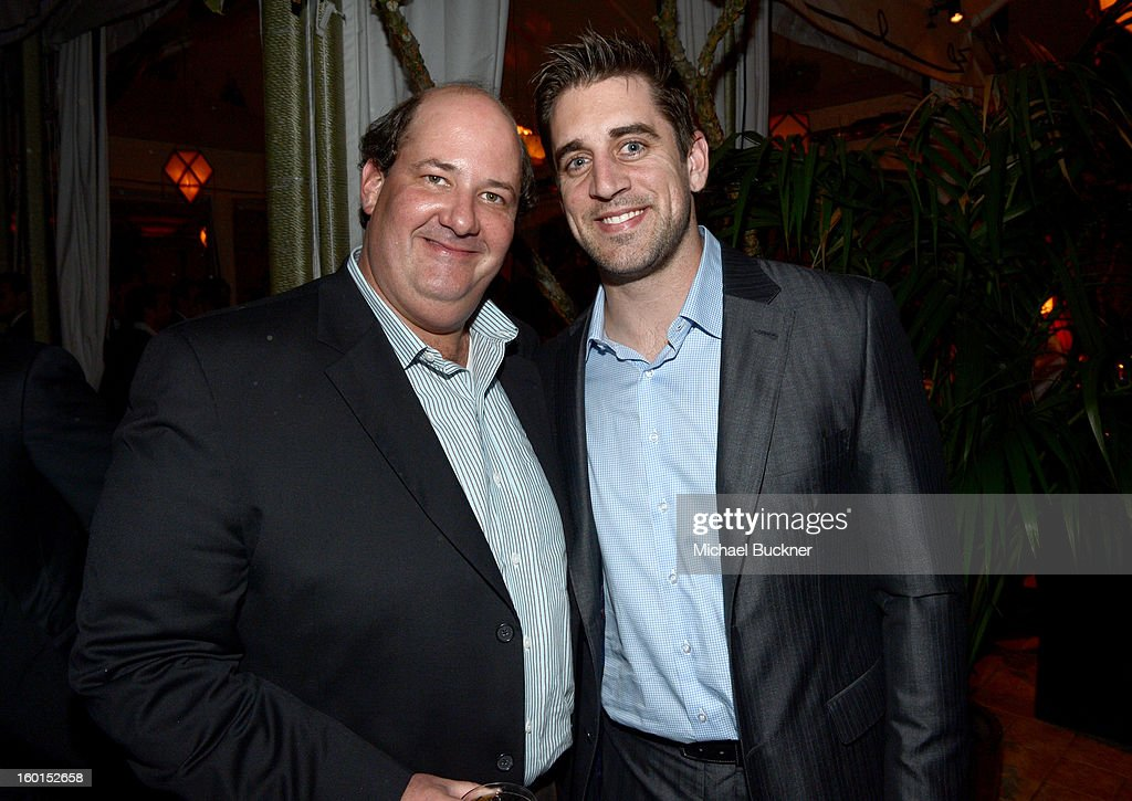 Actor Brian Baumgartner (L) and NFL quarterback Aaron Rodgers attends the Entertainment Weekly Pre-SAG Party hosted by Essie and Audi held at Chateau Marmont on January 26, 2013 in Los Angeles, California.