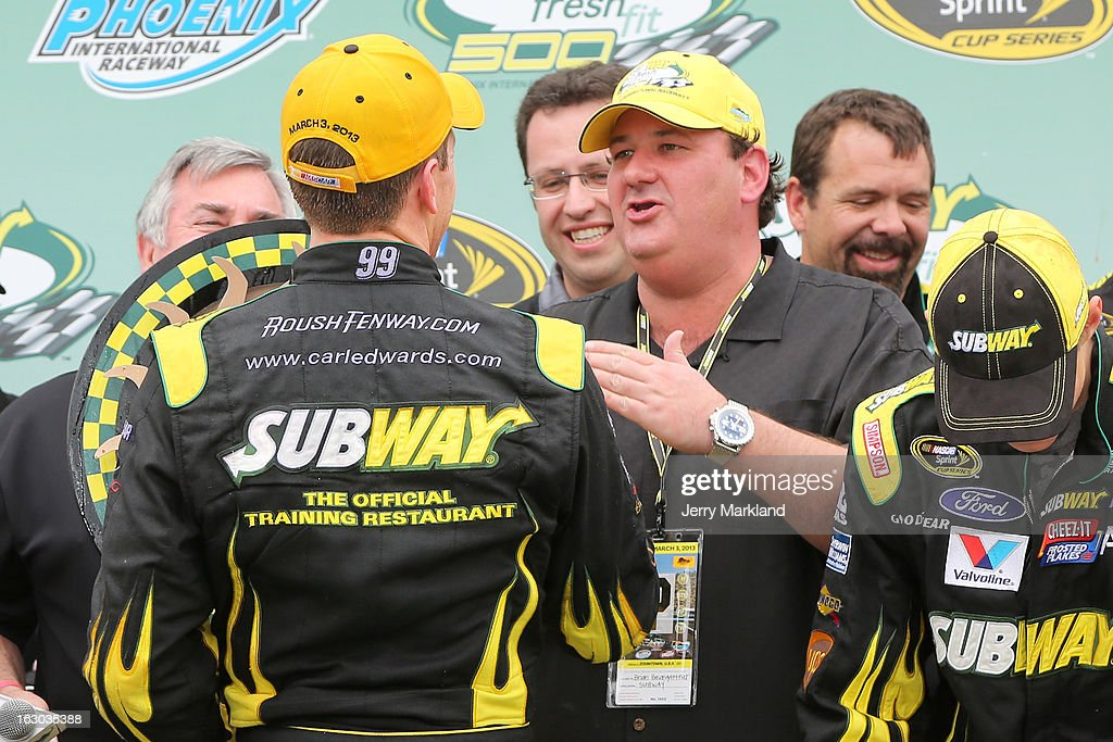 Actor Brian Baumgartner celebrates with Carl Edwards driver of the Subway Ford celebrates in victory lane after the NASCAR Sprint Cup Series Subway...