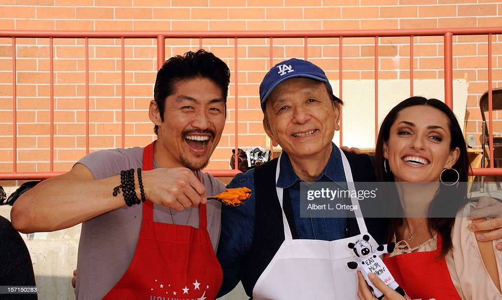 Actor Brian Tee, actor James Hong and actress Mirelly Taylor participate in the Hollywood Chamber of Commerce's annual police and firefighters appreciation day at the Hollywood LAPD station on November 28, 2012 in Hollywood, California.