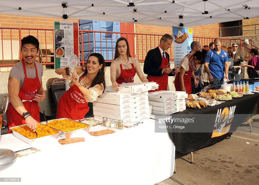 Actor Brian Tee, actress Mirelly Taylor, actress Erin Carufel and actor James Horan participate in the Hollywood Chamber of Commerce's annual police and firefighters appreciation day at the Hollywood LAPD station on November 28, 2012 in Hollywood, California.