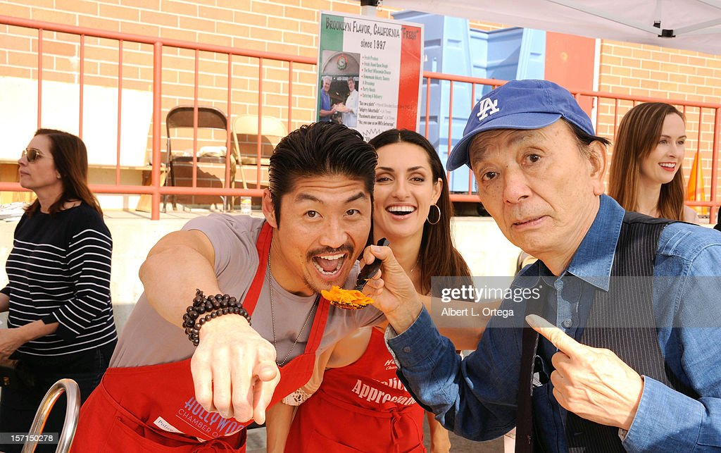 Actor Brian Tee, actress Mirelly Taylor and actor James Hong participate in the Hollywood Chamber of Commerce's annual police and firefighters appreciation day at the Hollywood LAPD station on November 28, 2012 in Hollywood, California.