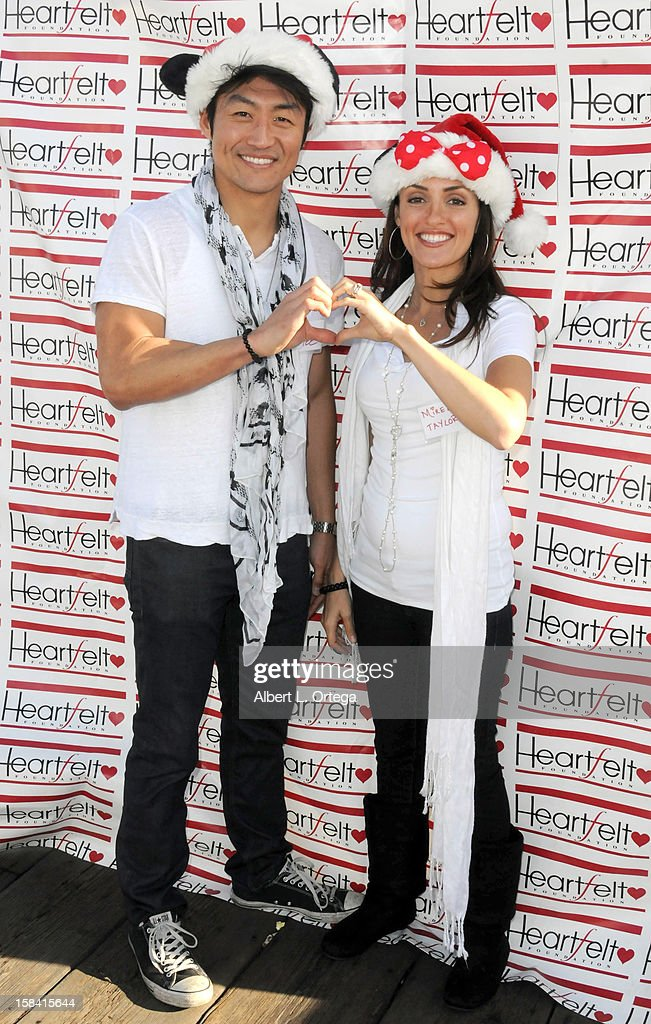 Actor Brian Tee and actress Mirelly Taylor participate in The Heartfelt Foundation's 33rd Annual Christmas/Holiday Party For Children In Need held at The Santa Monica Pier on December 15, 2012 in Santa Monica, California.