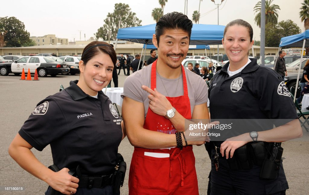 Actor Brian Tee participates in the Hollywood Chamber of Commerce's annual police and firefighters appreciation day at the Hollywood LAPD station on November 28, 2012 in Hollywood, California.