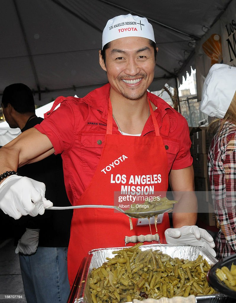 Actor Brian Tee participates in the Los Angeles Mission Christmas Eve lunch For The Homeless held at the Los Angeles Mission on December 24, 2012 in Los Angeles, California.