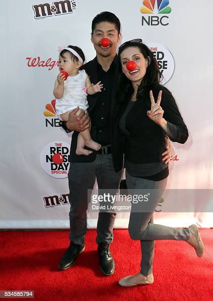 Actor Brian Tee wife actress Mirelly Taylor and daughter Madelyn Skyler Tee attend the Red Nose Day Special on NBC at the Alfred Hitchcock Theater at...
