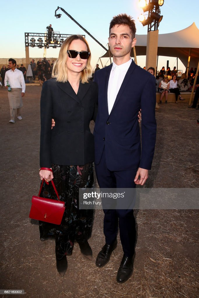 Actor Brie Larson (L) and musician Alex Greenwald attend the Christian Dior Cruise 2018 Runway Show at the Upper Las Virgenes Canyon Open Space Preserve on May 11, 2017 in Santa Monica, California.