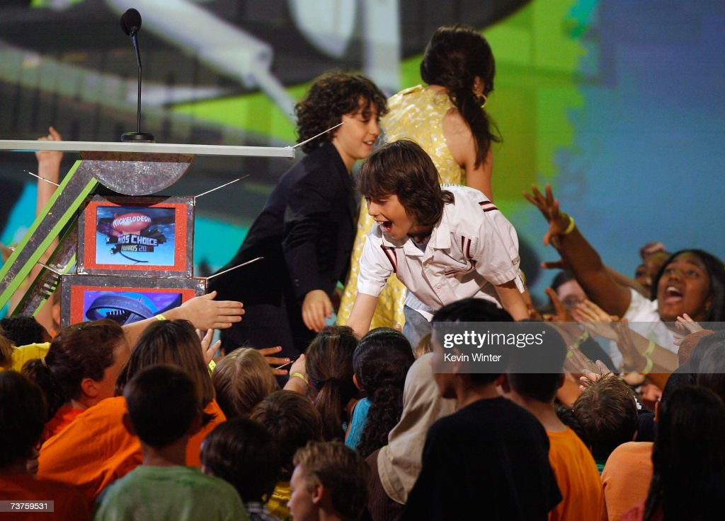 Actor brothers Alex Wolff and Nat Wolff shake hands with the audience onstage during the 20th Annual Kid's Choice Awards held at the UCLA Pauley...