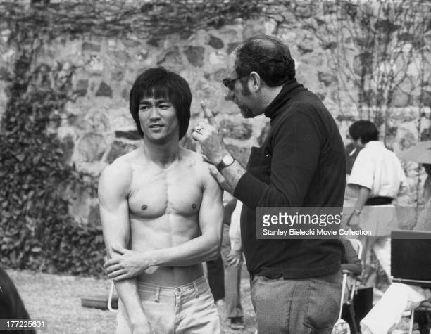 Actor Bruce Lee with producer Fred Weintraub on the set of the movie 'Enter the Dragon' 1973