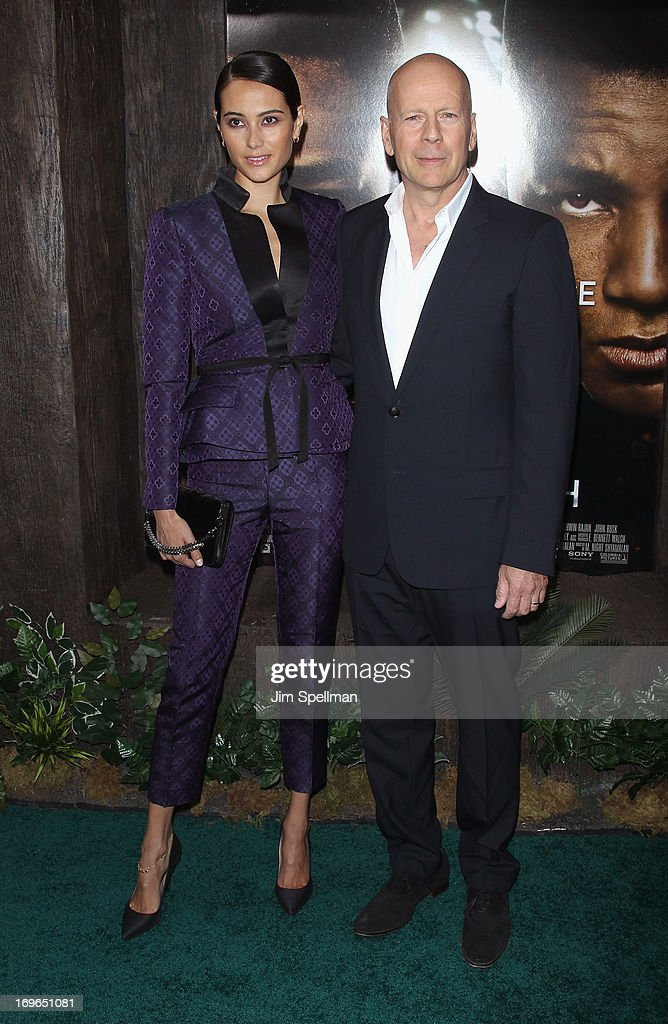 Actor Bruce Williis (R) and wife <a gi-track='captionPersonalityLinkClicked' href=/galleries/search?phrase=Emma+Heming&family=editorial&specificpeople=734062 ng-click='$event.stopPropagation()'>Emma Heming</a> attend the 'After Earth' premiere at the Ziegfeld Theater on May 29, 2013 in New York City.
