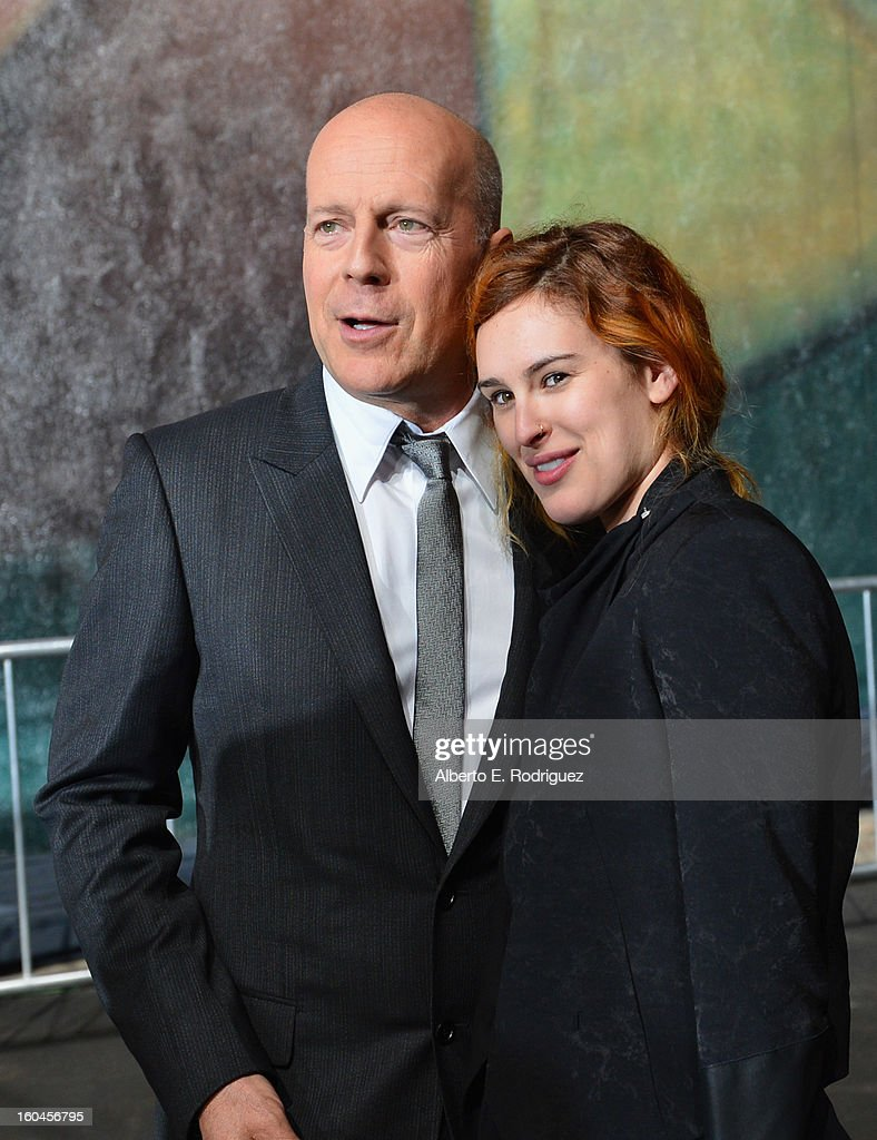 Actor <a gi-track='captionPersonalityLinkClicked' href=/galleries/search?phrase=Bruce+Willis&family=editorial&specificpeople=202185 ng-click='$event.stopPropagation()'>Bruce Willis</a> and actress <a gi-track='captionPersonalityLinkClicked' href=/galleries/search?phrase=Rumer+Willis&family=editorial&specificpeople=617003 ng-click='$event.stopPropagation()'>Rumer Willis</a> attend the dedication and unveiling of a new soundstage mural celebrating 25 years of 'Die Hard' at Fox Studio Lot on January 31, 2013 in Century City, California.