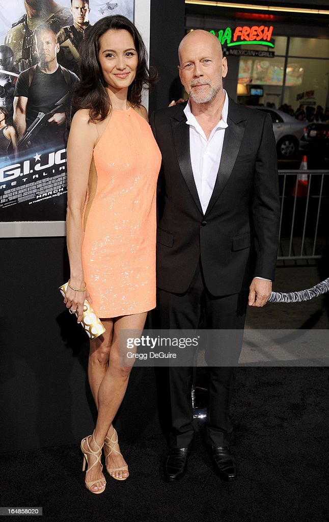 Actor Bruce Willis (R) and actress/model Emma Heming Willis arrive at the 'G.I. Joe: Retaliation' Los Angeles premiere at TCL Chinese Theatre on March 28, 2013 in Hollywood, California.