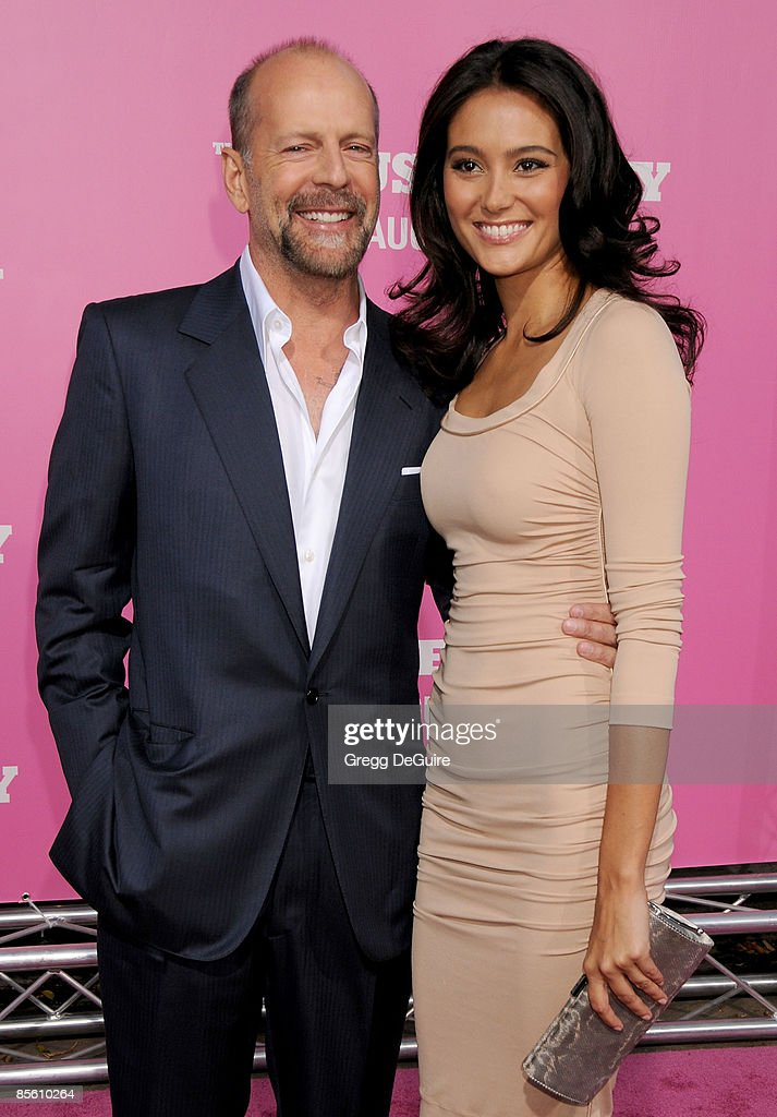 Actor Bruce Willis and Emma Heming arrive at Sony Pictures' Premiere of 'House Bunny' at the Mann Village Theatre on August 14, 2008 in Los Angeles, California.