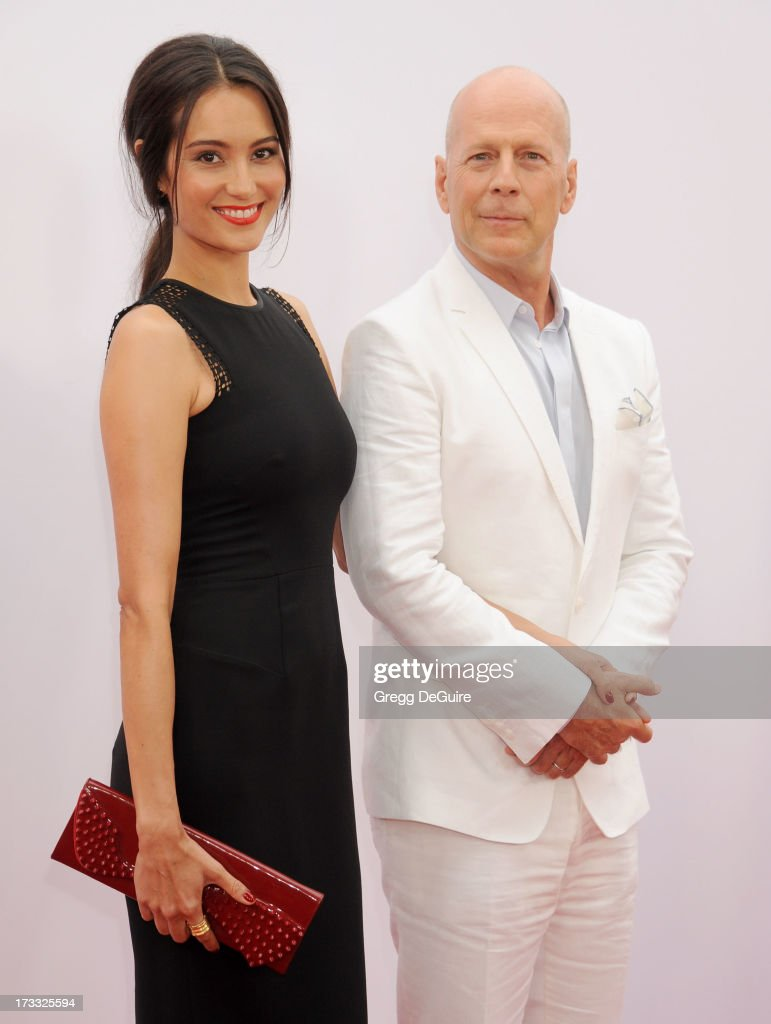 Actor <a gi-track='captionPersonalityLinkClicked' href=/galleries/search?phrase=Bruce+Willis&family=editorial&specificpeople=202185 ng-click='$event.stopPropagation()'>Bruce Willis</a> and <a gi-track='captionPersonalityLinkClicked' href=/galleries/search?phrase=Emma+Heming&family=editorial&specificpeople=734062 ng-click='$event.stopPropagation()'>Emma Heming</a> arrive at the Los Angeles premiere of 'Red 2' at Westwood Village on July 11, 2013 in Los Angeles, California.