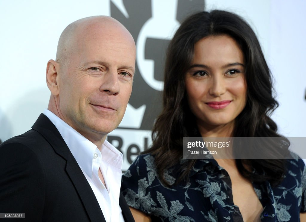 Actor <a gi-track='captionPersonalityLinkClicked' href=/galleries/search?phrase=Bruce+Willis&family=editorial&specificpeople=202185 ng-click='$event.stopPropagation()'>Bruce Willis</a> and <a gi-track='captionPersonalityLinkClicked' href=/galleries/search?phrase=Emma+Heming&family=editorial&specificpeople=734062 ng-click='$event.stopPropagation()'>Emma Heming</a> arrives at the Premiere Of Lionsgate Films' 'The Expendables' at the Grauman's Chinese Theatre on August 3, 2010 in Hollywood, California.