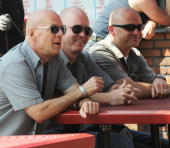 Actor Bruce Willis and his 'doubles' on location for 'A Couple of Dicks' at LB's Spumoni Gardens in Brooklyn on June 29 2009 in New York City