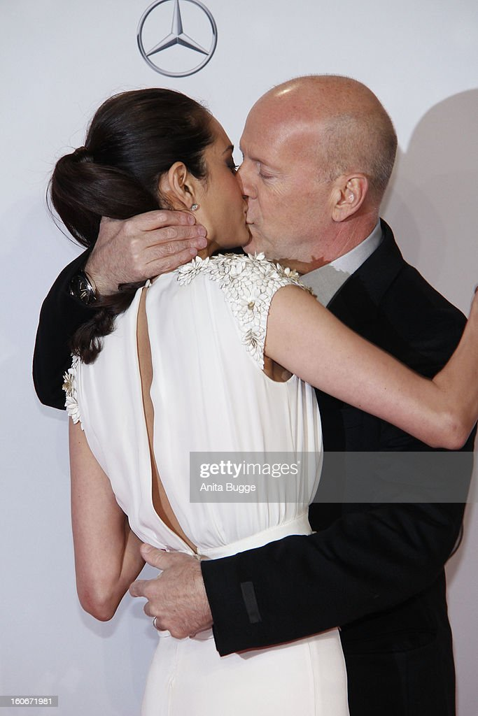 Actor <a gi-track='captionPersonalityLinkClicked' href=/galleries/search?phrase=Bruce+Willis&family=editorial&specificpeople=202185 ng-click='$event.stopPropagation()'>Bruce Willis</a> and his wife Emma Willis attend the 'Die Hard - Ein Guter Tag Zum Sterben' Germany premiere at CineStar Sony Center on February 4, 2013 in Berlin, Germany.