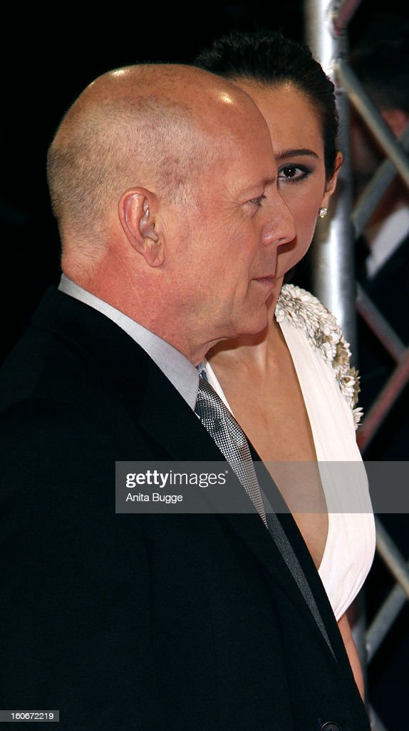 Actor Bruce Willis and his wife Emma Willis attend the 'Die Hard - Ein Guter Tag Zum Sterben' Germany premiere at CineStar Sony Center on February 4, 2013 in Berlin, Germany.