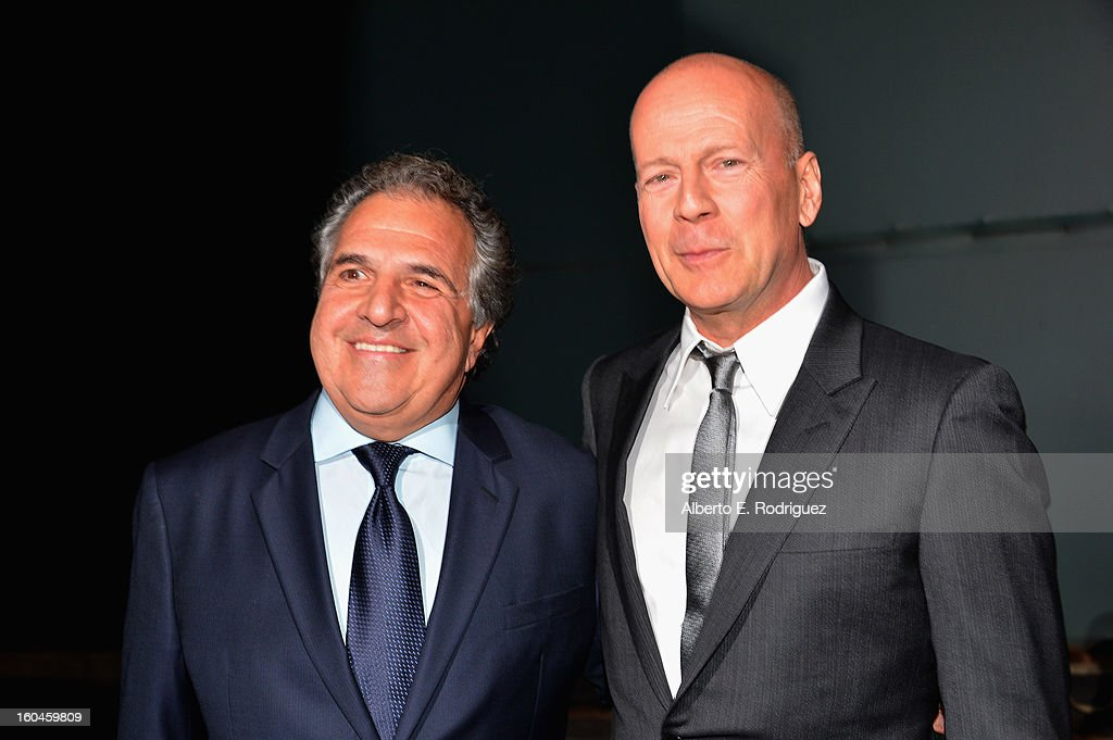 Actor Bruce Willis (R) and Jim Gianopulos, Co-Chairman & Chief Executive Officer of Fox Filmed Entertainment attend the dedication and unveiling of a new soundstage mural celebrating 25 years of 'Die Hard' at Fox Studio Lot on January 31, 2013 in Century City, California.