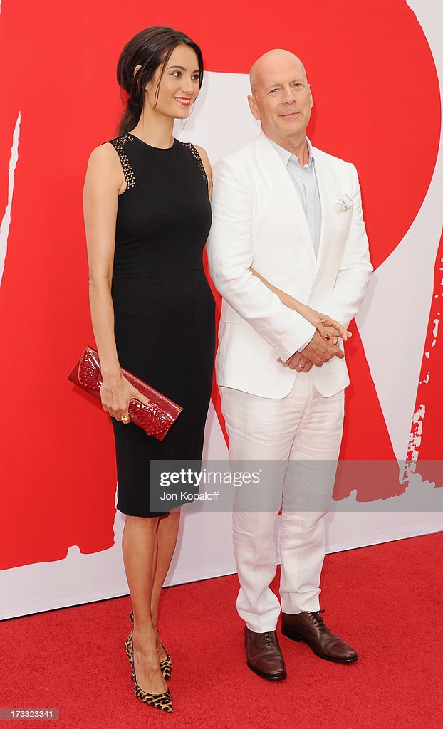 Actor Bruce Willis and wife Emma Heming arrive at the Los Angeles Premiere 'Red 2' at Westwood Village on July 11, 2013 in Los Angeles, California.