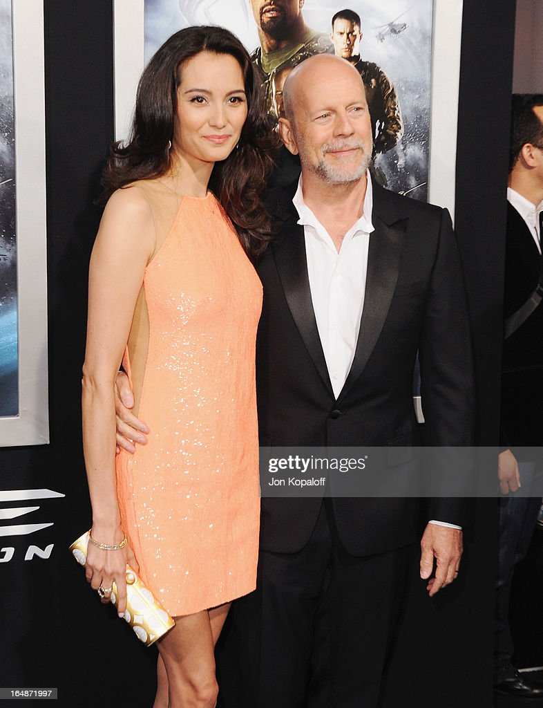 Actor Bruce Willis and wife Emma Heming arrive at the Los Angeles Premiere 'G.I. Joe: Retaliation' at TCL Chinese Theatre on March 28, 2013 in Hollywood, California.