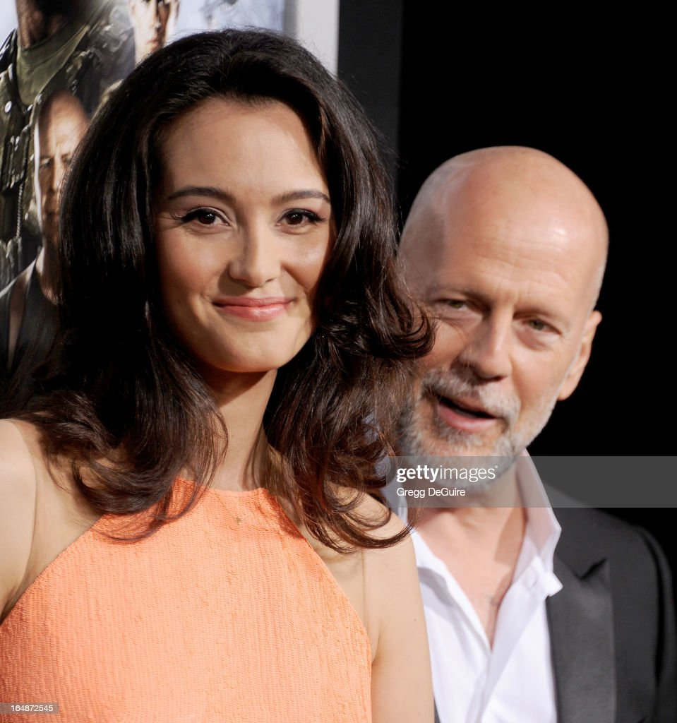 Actor Bruce Willis (R) and wife Emma Heming Willis arrive at the 'G.I. Joe: Retaliation' Los Angeles premiere at TCL Chinese Theatre on March 28, 2013 in Hollywood, California.