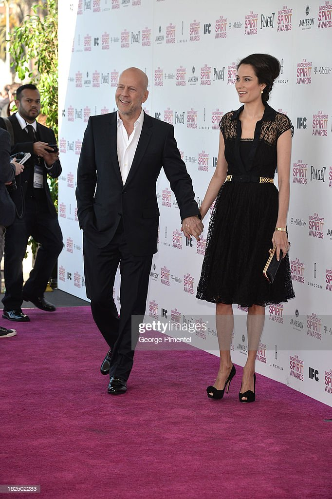Actor Bruce Willis and wife model Emma Heming arrive at the 2013 Film Independent Spirit Awards at Santa Monica Beach on February 23, 2013 in Santa Monica, California on February 23, 2013 in Santa Monica, California.
