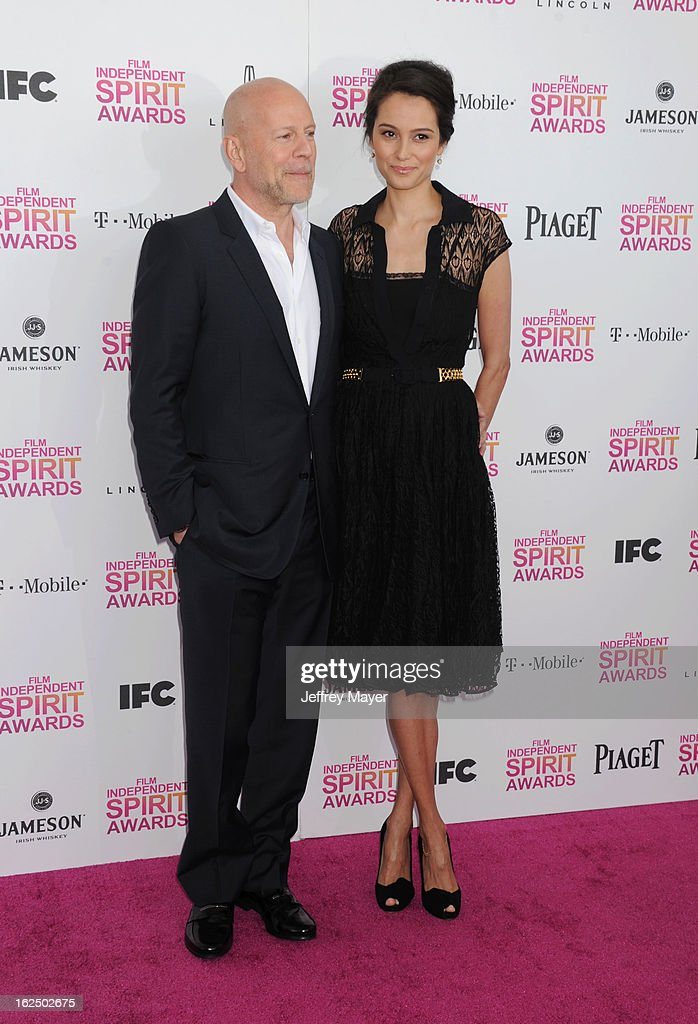 Actor Bruce Willis and wife/model Emma Heming attend the 2013 Film Independent Spirit Awards at Santa Monica Beach on February 23, 2013 in Santa Monica, California.