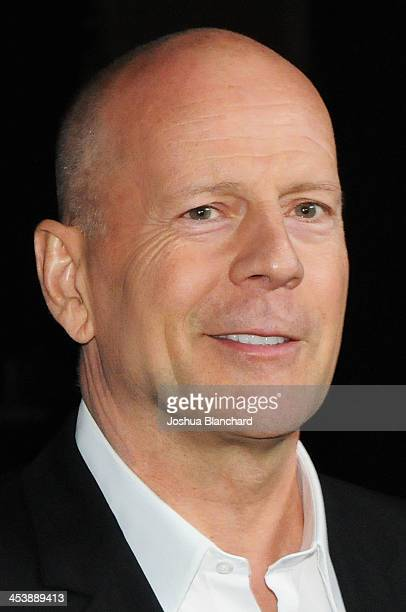 Actor Bruce Willis arrives at the Geffen Playhouse for the opening night of 'I'll Eat You Last A Chat with Sue Mengers' with Bette Midler on December...