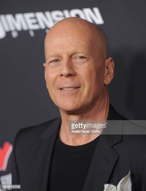 Actor Bruce Willis arrives at the Los Angeles premiere of 'Sin City A Dame To Kill For' at TCL Chinese Theatre on August 19 2014 in Hollywood...