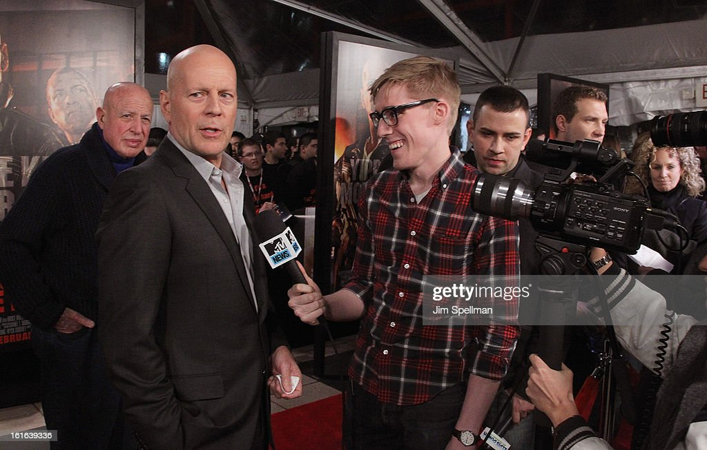 Actor Bruce Willis (L) attends the 'A Good Day To Die Hard' Fan Celebration at AMC Empire on February 13, 2013 in New York City.