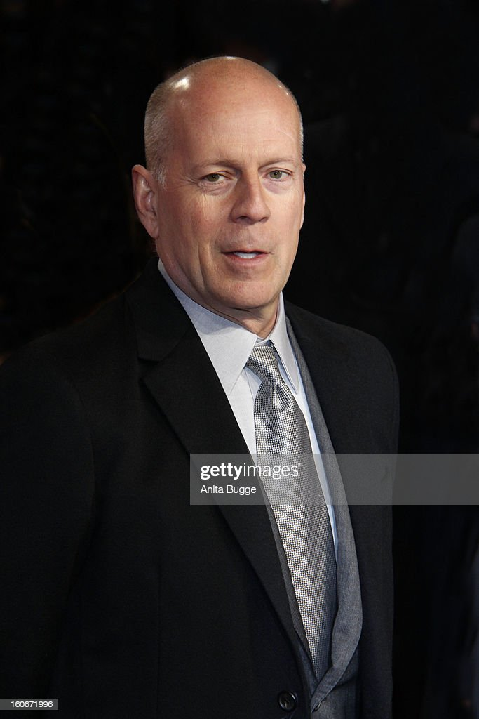 Actor Bruce Willis attends the 'Die Hard - Ein Guter Tag Zum Sterben' Germany premiere at CineStar Sony Center on February 4, 2013 in Berlin, Germany.