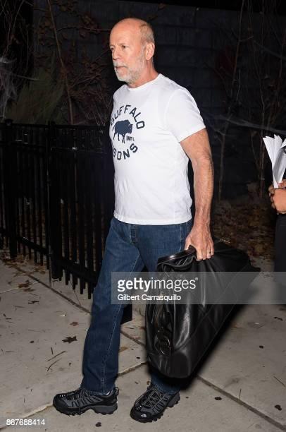 Actor Bruce Willis is seen leaving film director M Night Shyamalan's Halloween party 'Shyamaween' on October 28 2017 in Philadelphia Pennsylvania