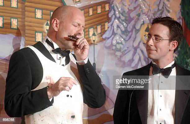 Actor Bruce Willis plays the harmonica for Joshua Bress at the Hasty Pudding Theatricals Man of the Year awards February 14 2002 in Cambridge MA Each...