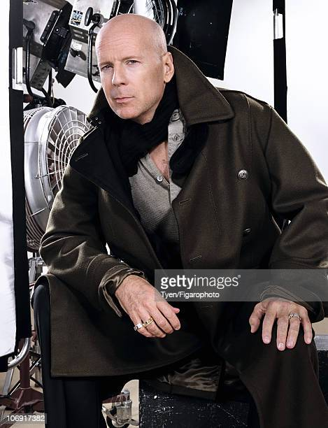 Actor Bruce Willis poses for Madame Figaro in Paris on June 15 2010 Published image Trench by John Galliano thermal shirt by Surplus Doursoux scarf...
