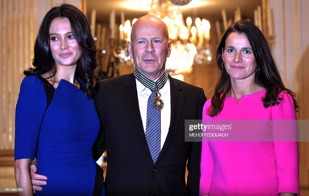 US actor Bruce Willis poses with his wife Emma Heming (L) and French Culture minister Aurelie Filippetti after being awarded as Commandeur des Arts et lettres (Commander in the Order of Arts and Letters) during a ceremony at the ministry in Paris on February 11, 2013.