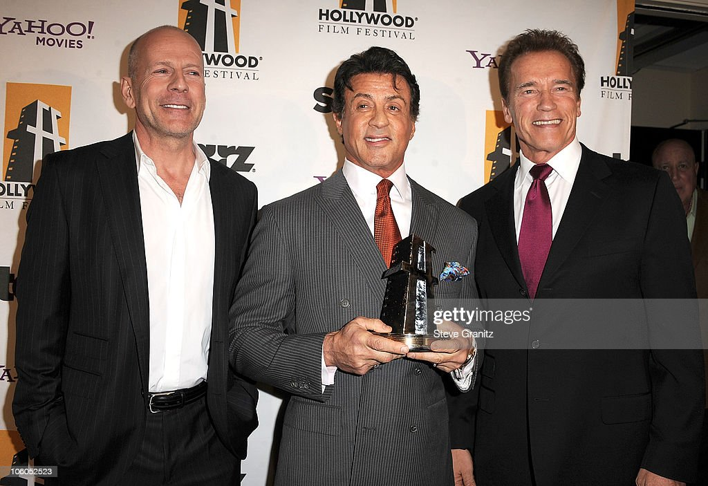 Actor Bruce Willis, producer/actor Sylvester Stallone, and Governor Arnold Schwarzenegger pose during the 14th annual Hollywood Awards Gala at The Beverly Hilton Hotel on October 25, 2010 in Beverly Hills, California.