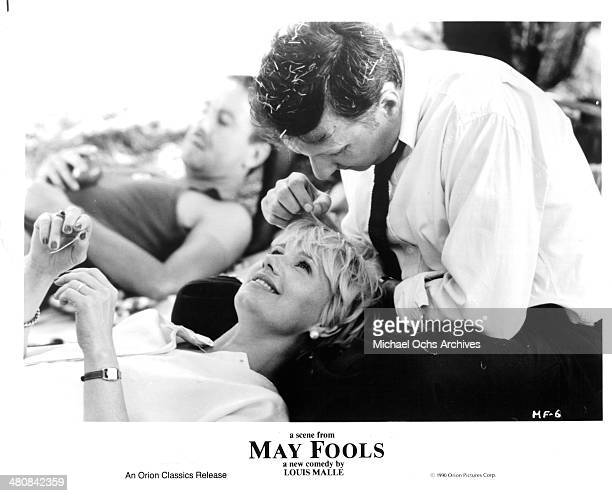 Actor Bruno Carette and actress MiouMiou in a scene from the movie ' May Fools ' circa 1990